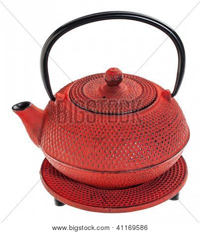 red hobnail tetsubin - cast iron traditional Japanese tea pot on a trivet, isolated on white