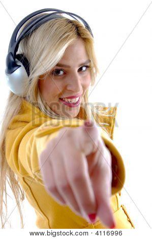 Side Pose Of Indicating Model Enjoying Music