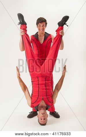Acrobat Holding Partner Upside Down