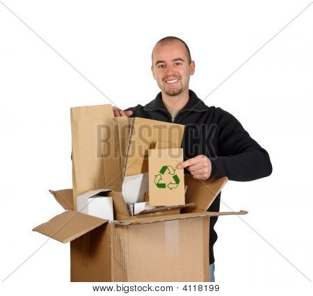 Young Man Recycling Cardboard
