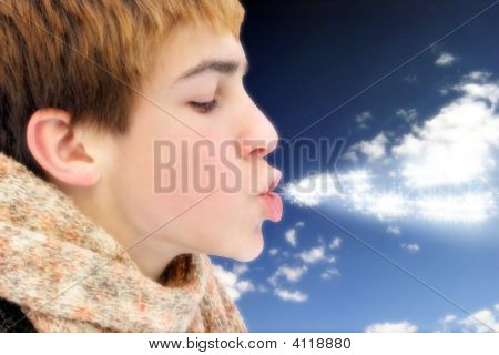 Teenager Blowing Magic Stars
