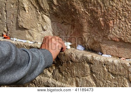 Hand Of Praying Man On The Western Wall  In Jerusalem