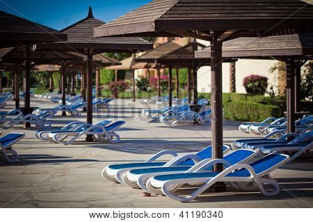 Sunloungers At The Swimming Pool