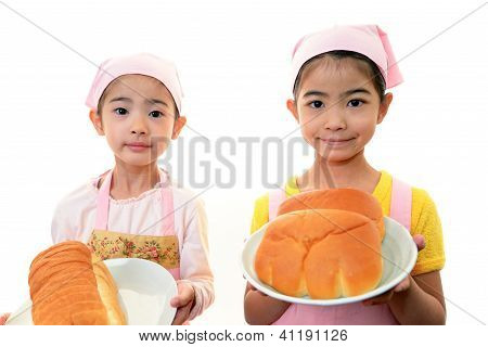 Happy children with breads