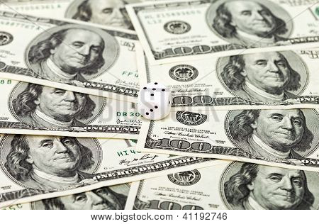 One Dice On Money Background - Business Concept
