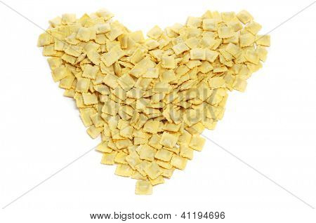 a pile of tortellini forming a heart on a white background