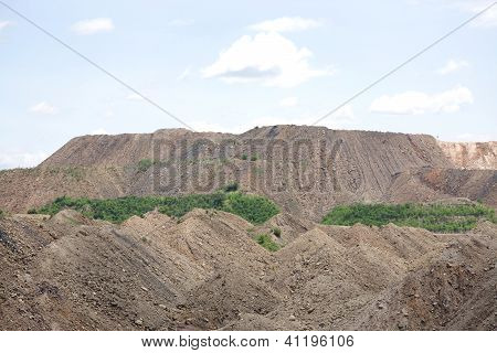 Debris/overburden mountain formed in the process of removal of coal