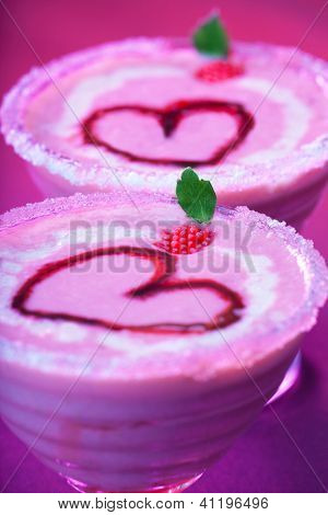 Image of tasty sundae with red romantic heart shape on the top, Valentine day holiday party, strawberry creamy smoothie with mint, nonalcoholic milk cocktail, cold ice cream, love concept