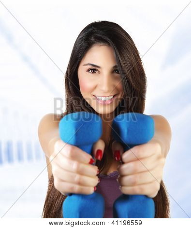 Photo of attractive sporty woman lifting dumbbell, active female doing fitness exercise indoor, isolated on white background, healthy lifestyle, training and loss weight, sport gym, health and beauty