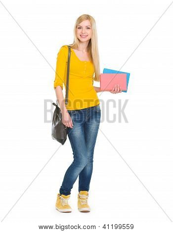 Full Length Portrait Of Teenage Student Girl With Books