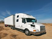 foto of oversize load  - White Truck with nice sky in background - JPG