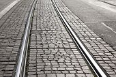 picture of tram  - Metal Tram Track on Cobbled Stone Street - JPG