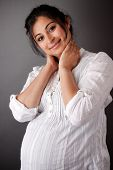pic of east-indian  - Portrait of a smiling pregnant East Indian woman - JPG