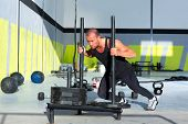 stock photo of sled  - sled push man pushing weights workout exercise - JPG