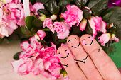 picture of threesome  - concept of a valentine threesome with a flower background - JPG