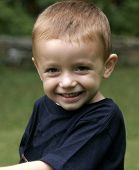 picture of young boy  - young boy smiling at camera - JPG