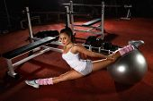 image of leg-split  - Woman exercising Pilates ball workout posture in fitness club - JPG