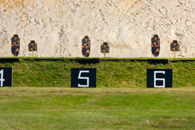 foto of shooting-range  - A series of targets with spotting discs on a rifle range - JPG