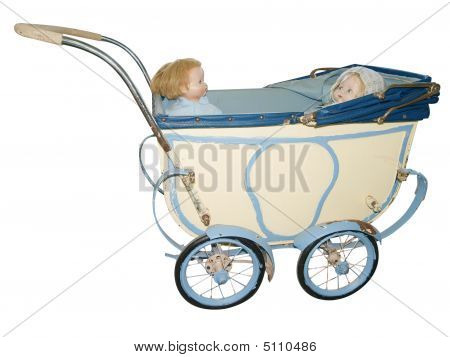 Two Dolls In An Antique Pram