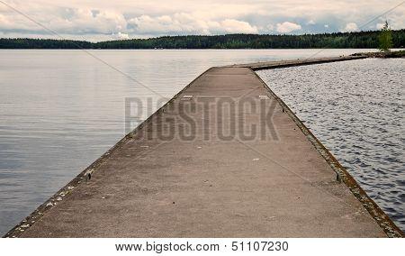 Old Concrete Pier On Calm Lake Harbor In Imatra Town, Finland