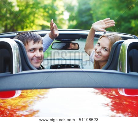 Couple In Red Cabriolet In A Sunny Day