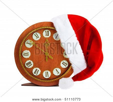 Santa Claus Hat On New Year's Night On The Old Clock Showing Twelve O'clock