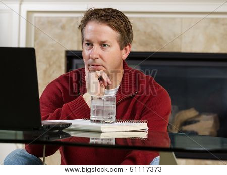 Mature Man Making Decision While Working At Home