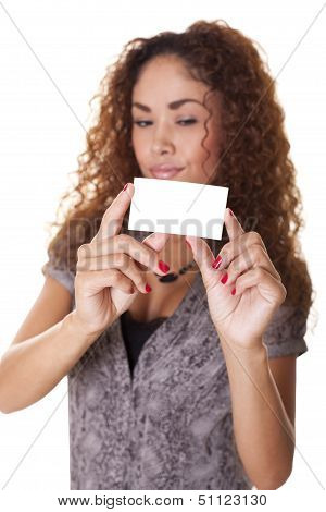 Latin Woman Holds A Blank Business Card.