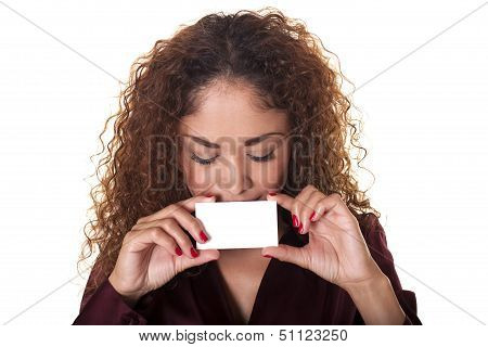 Woman Peeks Over A Blank Business Card.