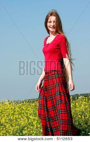 Happy Girl On Yellow Meadow