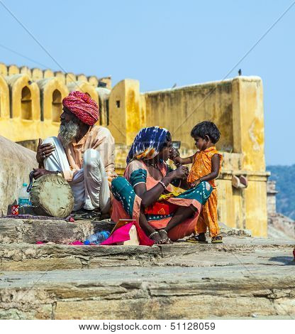 Woman Begs For Money With Her Child Sitting At The Entrance Of Amber Fort