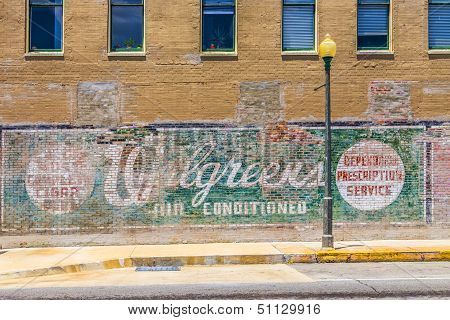 Old Painted Advertising At The Wall