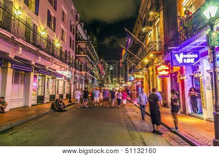 People On The Move In The Burbon Street At Night In The French Quarter