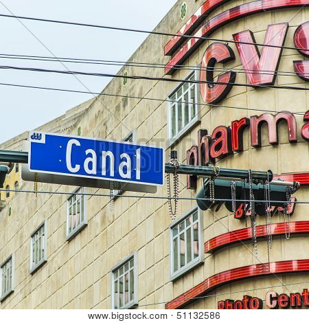 NEW ORLEANS USA - JULY 15, 2013: street sign Canal in french Quarter in new Orleans. Canal Street is a major thoroughfare in the city of New Orleans and often said to be the widest roadway in America.