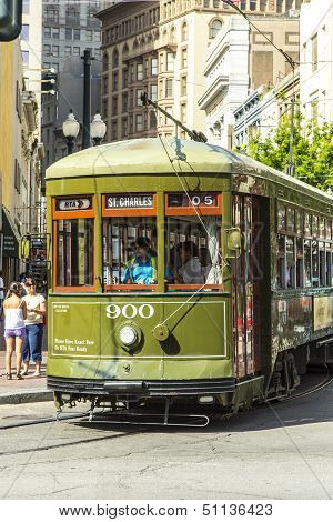 Green Trolley Streetcar On Rail In New Orleans French Quarter