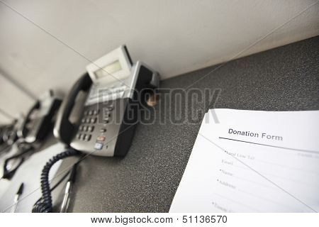 Landline telephones and document on table in office