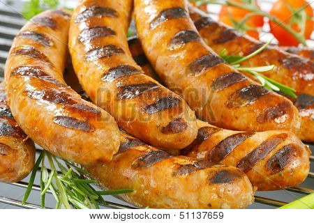 grilled sausages on an iron grilling grid