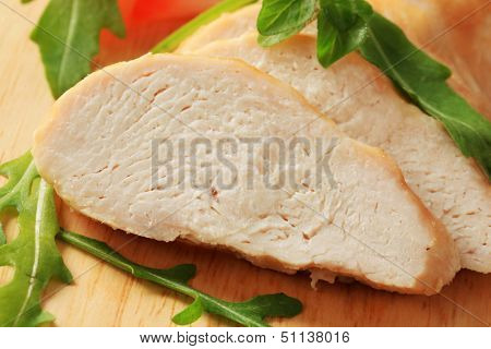 Sliced chicken breast fillet on a cutting board