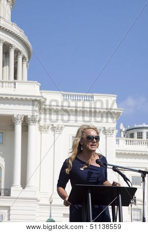 WASHINGTON-SEPT 11: Journalist Scottie Nell Hughes speaks at the 911 Justice for Benghazi rally at the US Capitol on September 11, 2013 in Washington,DC. The event pushed for H.Res. 36 and H.Res. 306.