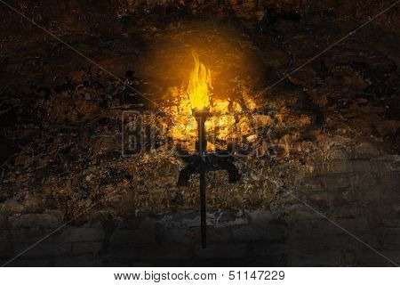 Torch On The Wall Of An Old Castle