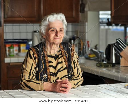 Portrait Of A Senior Woman In The Kitchen