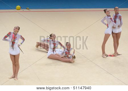 KIEV, UKRAINE - SEPTEMBER 1: Team Ukraine performs the routing with clubs during the 32nd Rhythmic Gymnastics World Championships in Kiev, Ukraine on September 1, 2013