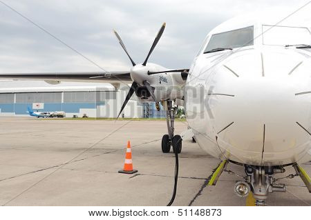 RIGA, LATVIA - JUNE 16, 2011: Air Baltic propeller airplane in Riga airport. Air Baltic is the Latvian flag carrier airline and a low-cost carrier. June 16, 2011 in Riga, Latvia.