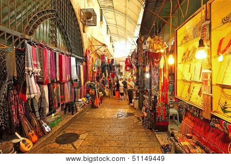JERUSALEM - AUGUST 21: Old city bazaar offers middle east traditional products and souvenirs. It is very popular with tourists and pilgrims visiting the city in Jerusalem, Israel on August 21, 2013.
