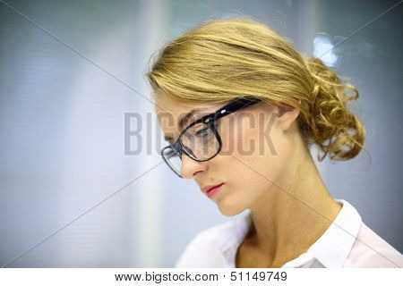 Face portrait of a serious girl with glasses