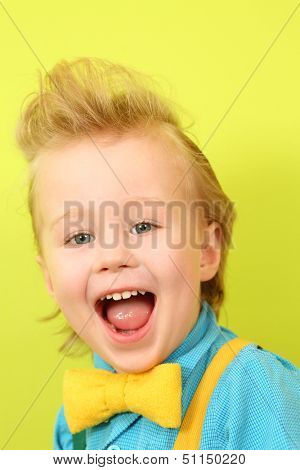 Portrait of a screaming mod boy in blue checkered shirt and a yellow bow tie