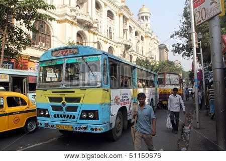 KOLKATA, INDIA - NOVEMBER 24:People on the move come in the colorful bus on November 24, 2012 in Kolkata, India. Kolkata and its suburbs, is home to approximately 14.1 million people.