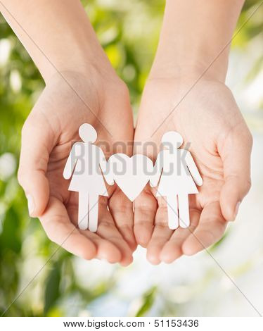 eco, bio, nature, love, harmony concept - woman hands showing two paper women with heart shape