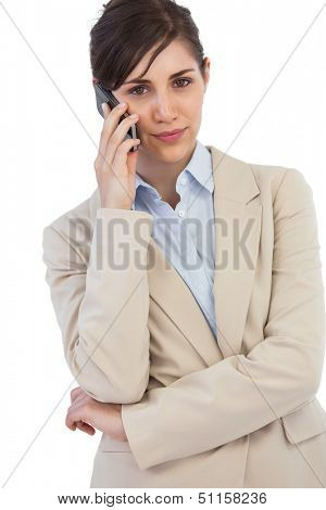 Self assured businesswoman on the phone against white background