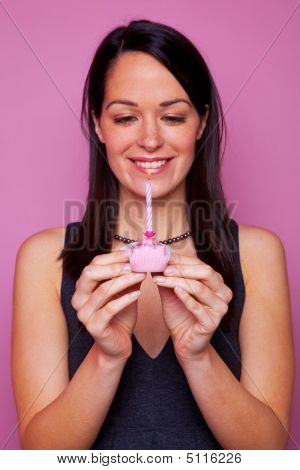 Woman With A Small Birthday Cake